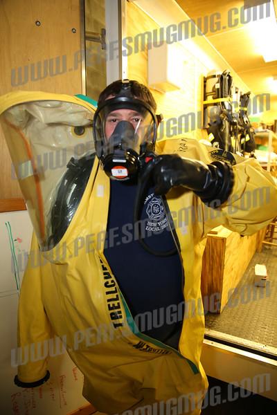 Hazmat Specialist Dan Soper dons his Level A Hazmat suit