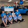 North End Subaru in Lunenburg presented a $18,515 check to the Boys and Girls Clubs of Lunenburg and Leominster on Friday afternoon. Back row; Joe Altavilla, Martin Babineau and Jesse Manning, all of North End Subaru, Michelle Bellezza of the Lunenburg Boys and Girls Club and Lunenburg Selectman Jamie Toale. Kids from the Lunenburg Boys and Girls Club include (back) Katie Motyka, Mackenzie Bellezza, Molly Bellezza, Elise Lilly and Daniel Motyka; front row Kate Vallee, Amanda Bertrand, Olivia Waldron and Bradley Gray. SENTINEL & ENTERPRISE / Ashley Green