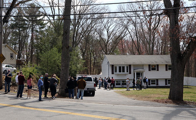 A real estate open house at 1 Oak Street in Billerica attracts a long line of househunters, some who've been looking since November. Asking price was $499,900.  JULIA MALAKIE/LOWELLSUN