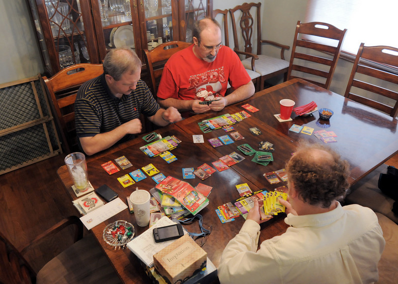 BE0127game15<br /> Philip Manoff, left, Dan Barber and Sterling Babcock play the Glory to Rome game at the 104th gaming event by Time Well Spent Games at Dave Jones home in Eagle Trace on Saturday. <br /> <br /> January 22, 2011<br /> staff photo/David R. Jennings