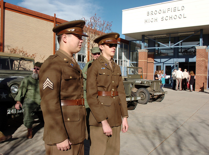 Military re-enactors Jared Schroeder, 16, left, and Tim Edwards, 16, greet attendees to the Broomfield Veteran's Memorial Museum's annual Veterans Day ceremony at Broomfield High School on Friday.<br /> <br /> <br /> November 11, 2011<br /> staff photo/ David R. Jennings