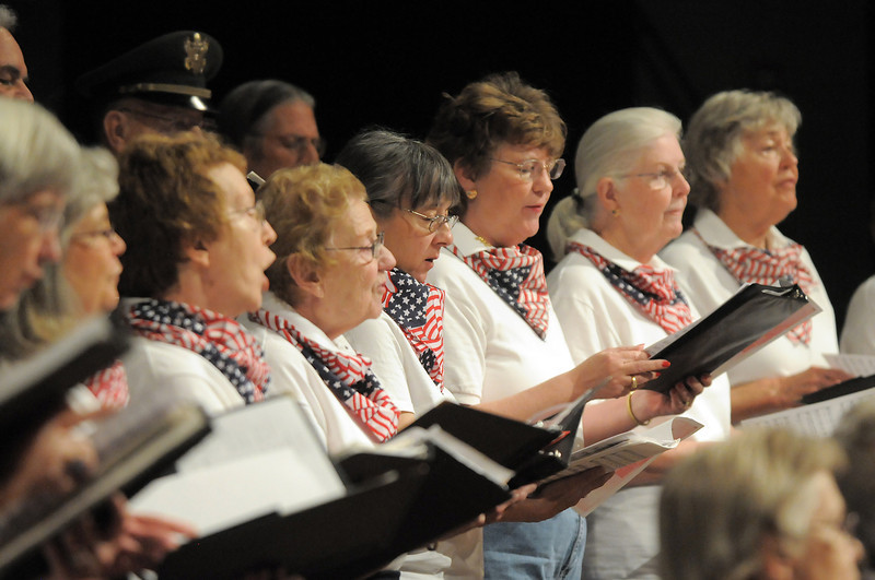 The Broomfield Civic Chorus sings patriotic songs during the Broomfield Veteran's Memorial Museum's annual Veterans Day ceremony at Broomfield High School on Friday.<br /> <br /> <br /> November 11, 2011<br /> staff photo/ David R. Jennings
