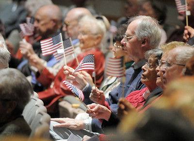 The audience wave their flags during the 101st Army National Guard Band's performance at the Broomfield Veteran's Memorial Museum's annual Veterans Day ceremony at Broomfield High School on Friday.   November 11, 2011 staff photo/ David R. Jennings