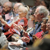 The audience wave their flags during the 101st Army National Guard Band's performance at the Broomfield Veteran's Memorial Museum's annual Veterans Day ceremony at Broomfield High School on Friday.<br /> <br /> <br /> November 11, 2011<br /> staff photo/ David R. Jennings