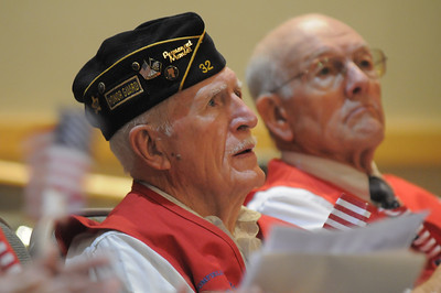 US Navy World War II veteran Wayne Burt, left, and Jim Sparks listen to the keynote address during the Broomfield Veteran's Memorial Museum's annual Veterans Day ceremony at Broomfield High School on Friday.   November 11, 2011 staff photo/ David R. Jennings