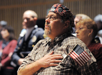 Bruce Tansey, 49, salutes during the Broomfield Veteran's Memorial Museum's annual Veterans Day ceremony at Broomfield High School on Friday. Tansey's cousin died in Vietnam and his uncle served in World War II surviving from D-Day to the final assault on Berlin with out a scratch.     November 11, 2011 staff photo/ David R. Jennings