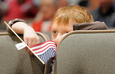 Ethan Cline, 6, watches a listens to the 101st Army National Guard Band play during the Broomfield Veteran's Memorial Museum's annual Veterans Day ceremony at Broomfield High School on Friday.   November 11, 2011 staff photo/ David R. Jennings