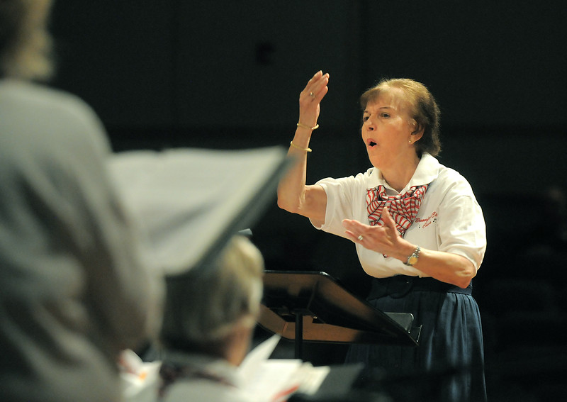 Barbara Schipper directs the Broomfield Civic Chorus during the Broomfield Veteran's Memorial Museum's annual Veterans Day ceremony at Broomfield High School on Friday.<br /> <br /> <br /> November 11, 2011<br /> staff photo/ David R. Jennings