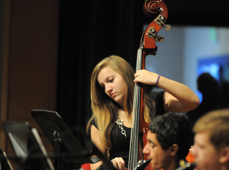 Hannah Blough, 15, plays the bass while performing with the Broomfield High School Jazz Band during the Broomfield Veteran's Memorial Museum's annual Veterans Day ceremony at Broomfield High School on Friday.<br /> <br /> <br /> November 11, 2011<br /> staff photo/ David R. Jennings