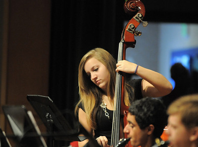 Hannah Blough, 15, plays the bass while performing with the Broomfield High School Jazz Band during the Broomfield Veteran's Memorial Museum's annual Veterans Day ceremony at Broomfield High School on Friday.   November 11, 2011 staff photo/ David R. Jennings