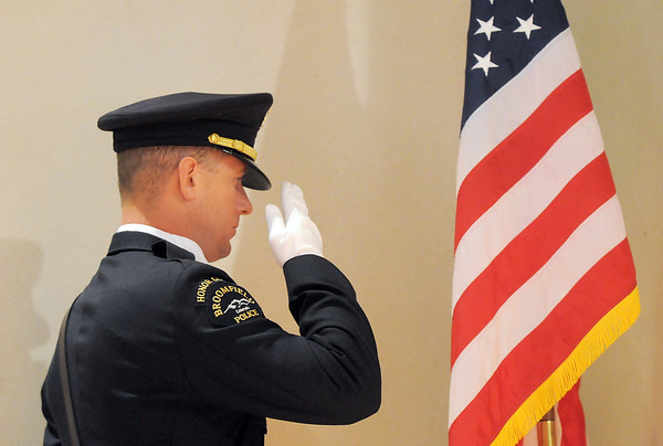 Broomfield Police Honor Guard officer Todd Dahlbach salutes during the singing of the National Anthem at the Broomfield Veteran's Memorial Museum's annual Veterans Day ceremony at Broomfield High School on Friday.<br /> <br /> <br /> November 11, 2011<br /> staff photo/ David R. Jennings