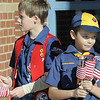 Cub Scouts Owen Cunnington, 10, left, and Graham Crosbie, 7, with Pack 586 hand out Mini Healing Field flags to attendees of the Broomfield Veteran's Memorial Museum's annual Veterans Day ceremony at Broomfield High School on Friday. Each flag has the name of a person who died in the 9/11 attacks.<br /> <br /> <br /> November 11, 2011<br /> staff photo/ David R. Jennings