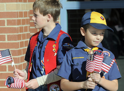 Cub Scouts Owen Cunnington, 10, left, and Graham Crosbie, 7, with Pack 586 hand out Mini Healing Field flags to attendees of the Broomfield Veteran's Memorial Museum's annual Veterans Day ceremony at Broomfield High School on Friday. Each flag has the name of a person who died in the 9/11 attacks.   November 11, 2011 staff photo/ David R. Jennings