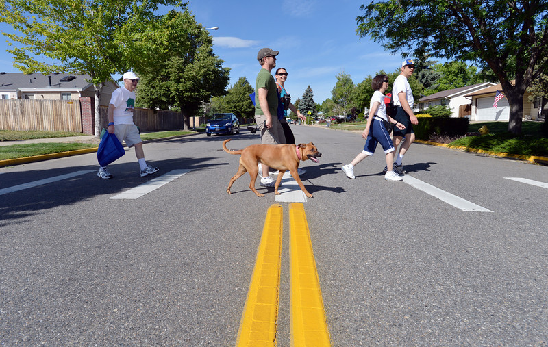 Participants cross 132nd Ave. during the 11th Annual Trail Adventure in the Westlake neighborhood on Saturday.<br /> June 2, 2012 <br /> staff photo/ David R. Jennings