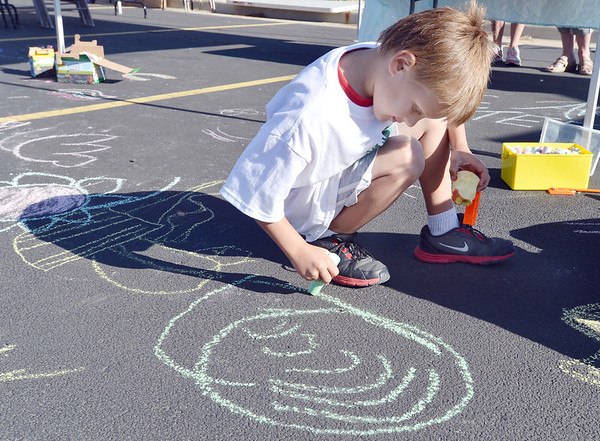 Will Tennyson, 7, makes a chalk drawing in the parking lot of the LDS Church during the 11th Annual Trail Adventure in the Westlake neighborhood on Saturday.<br /> June 2, 2012 <br /> staff photo/ David R. Jennings