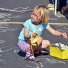 Lucy Hansen, 3, eats a banana while making a chalk drawing during the 11th Annual Trail Adventure in the Westlake neighborhood on Saturday.<br /> June 2, 2012 <br /> staff photo/ David R. Jennings