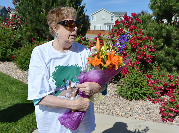 Edie Johnson received flowers in honor of her husband, Ralph, who the walk was dedicated during the 11th Annual Trail Adventure in the Westlake neighborhood on Saturday.<br /> June 2, 2012 <br /> staff photo/ David R. Jennings