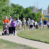 Walk participants travel on the sidewalk around alex and Mihael's Pond during the 11th Annual Trail Adventure in the Westlake neighborhood on Saturday.<br /> June 2, 2012 <br /> staff photo/ David R. Jennings