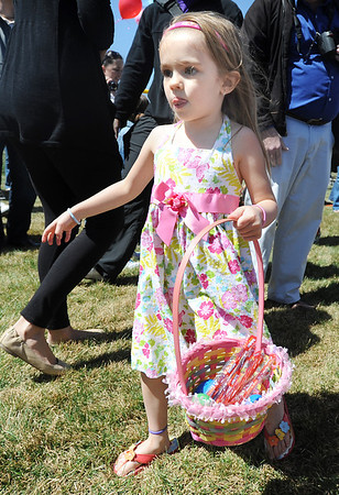 Alexis Beasley, 4, looks for candy to fill her basket during the 18th Annual Eggstravaganza Egg Scramble at John Shaw Field in Community Park on Saturday.<br /> April 7, 2012 <br /> staff photo/ David R. Jennings