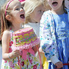 Alexis Beazley, 4, left, and alexis English, 5,  yell with other children that they are ready to gather candy and plastic eggs filled with prizes during the 18th Annual Eggstravaganza Egg Scramble at John Shaw Field in Community Park on Saturday.<br /> April 7, 2012 <br /> staff photo/ David R. Jennings