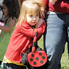 Kadence Clark, 2, holds on to her mother Raleigh, before the 0-2 eg scramble at the 18th Annual Eggstravaganza Egg Scramble at John Shaw Field in Community Park on Saturday.<br /> April 7, 2012 <br /> staff photo/ David R. Jennings