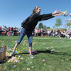 Volunteer Kiera Benson, 17, helps throw out candy for the 18th Annual Eggstravaganza Egg Scramble at John Shaw Field in Community Park on Saturday.<br /> April 7, 2012 <br /> staff photo/ David R. Jennings