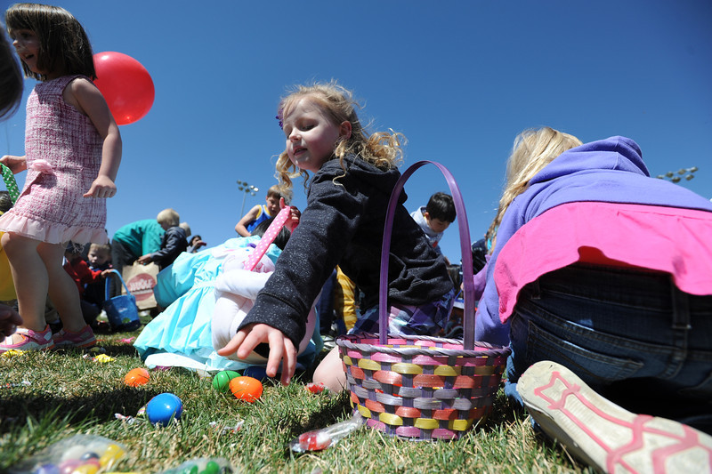 Children gahter candy and platsic eggs filled with prizes during the 18th Annual Eggstravaganza Egg Scramble at John Shaw Field in Community Park on Saturday.<br /> April 7, 2012 <br /> staff photo/ David R. Jennings