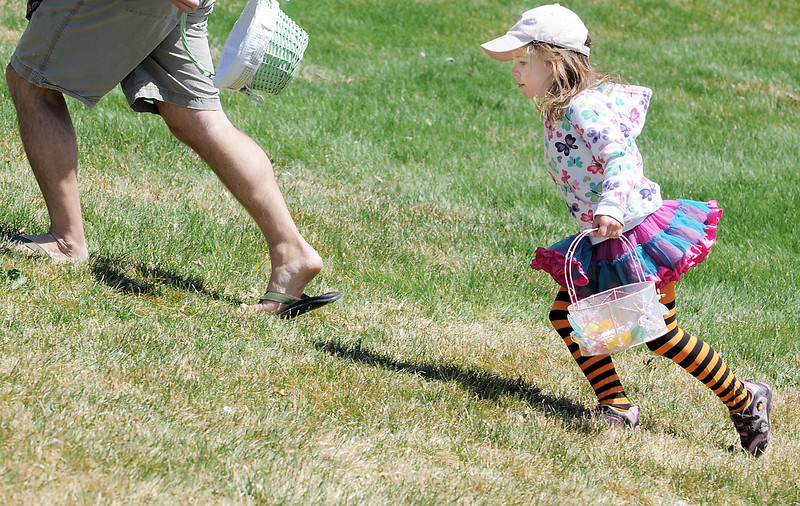 Hannah Drexel, 5, follows her father up a slope after the Eggstravaganza the 18th Annual Egg Scramble at John Shaw Field in Community Park on Saturday.<br /> April 7, 2012 <br /> staff photo/ David R. Jennings