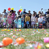 Children wait with their parents and relatives before running out to gather candy and platic eggs filled with prizes during the 18th Annual Eggstravaganza Egg Scramble at John Shaw Field in Community Park on Saturday.<br /> April 7, 2012 <br /> staff photo/ David R. Jennings