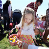 Anna Lanford, 2, fills her basket with plastic eggs and candy during the 18th Annual Eggstravaganza Egg Scramble at John Shaw Field in Community Park on Saturday.<br /> April 7, 2012 <br /> staff photo/ David R. Jennings