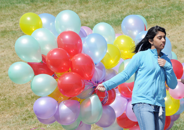 Volunteer Meghan Sharma, 14, carries ballons to give to children during the 18th Annual Eggstravaganza Egg Scramble at John Shaw Field in Community Park on Saturday.<br /> April 7, 2012 <br /> staff photo/ David R. Jennings