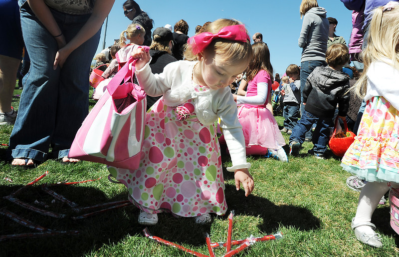 Alexa Vissers, 2, gathers candy during the 18th Annual Eggstravaganza Egg Scramble at John Shaw Field in Community Park on Saturday.<br /> April 7, 2012 <br /> staff photo/ David R. Jennings