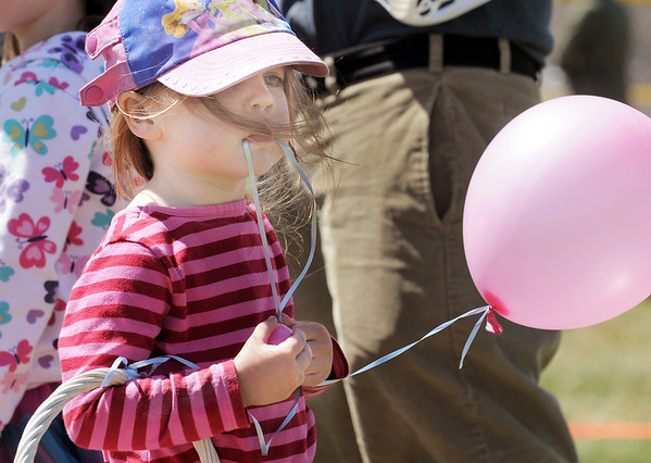 Birdie Drexel, 3, holds a plastic egg and a balloon after the 18th Annual Eggstravaganza Egg Scramble at John Shaw Field in Community Park on Saturday.<br /> April 7, 2012 <br /> staff photo/ David R. Jennings