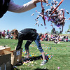 Volunteer Kiera Benson, 17,helps throw out candy for the 18th Annual Eggstravaganza Egg Scramble at John Shaw Field in Community Park on Saturday.<br /> April 7, 2012 <br /> staff photo/ David R. Jennings