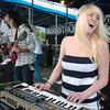 Caitlin Gardner plays keyboards with Carmel Carmela at Broomstock.<br /> Photo: David Jennings