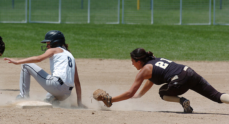 Colorado Stars Bella Bravo, right, reaches to try and tag out Kansas City Glory's Kendyll Bailey during the 2011 Colorado Fireworks Softball Tournament 12U softball championship game at Community Park on Monday.<br /> <br /> July 4, 2011<br /> staff photo/ David R. Jennings