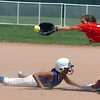 Birmingham Mustangs' Kaleigh Todd, left,  slides safley to second base past Texas Glory's G. Stichantski during the 2011 Colorado Fireworks Softball Tournament 14U softball championship game at Community Park on Monday.<br /> <br /> July 4, 2011<br /> staff photo/ David R. Jennings