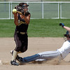 Colorado Stars second baseman Kendil Strong, left, throws to firstbase after tagging out Kansas City Glory's Ashlyn Sutton during the 2011 Colorado Fireworks Softball Tournament 12U softball championship game at Community Park on Monday.<br /> <br /> July 4, 2011<br /> staff photo/ David R. Jennings