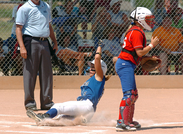 Birmingham Mustangs's Katlyn Sides, left, slides to home past Texas Glory's catcher M.Voouhagel during 2011 the Colorado Fireworks Softball Tournament 14U softball championship game at Community Park on Monday.<br /> <br /> July 4, 2011<br /> staff photo/ David R. Jennings