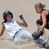 Colordao Stars third baseman Riley Craig, right,  tags out Kansa City Glory's Bobbi Bodenhamer during the 2011 Colorado Fireworks Softball Tournament 12U softball championship game at Community Park on Monday.<br /> <br /> July 4, 2011<br /> staff photo/ David R. Jennings