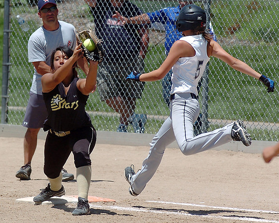 Colorado Stars first baseman Vic Macias, left, forces out Kansas City Glory's Ashlyn Sutton during the 2011 Colorado Fireworks Softball Tournament 12U softball championship game at Community Park on Monday.<br /> <br /> July 4, 2011<br /> staff photo/ David R. Jennings