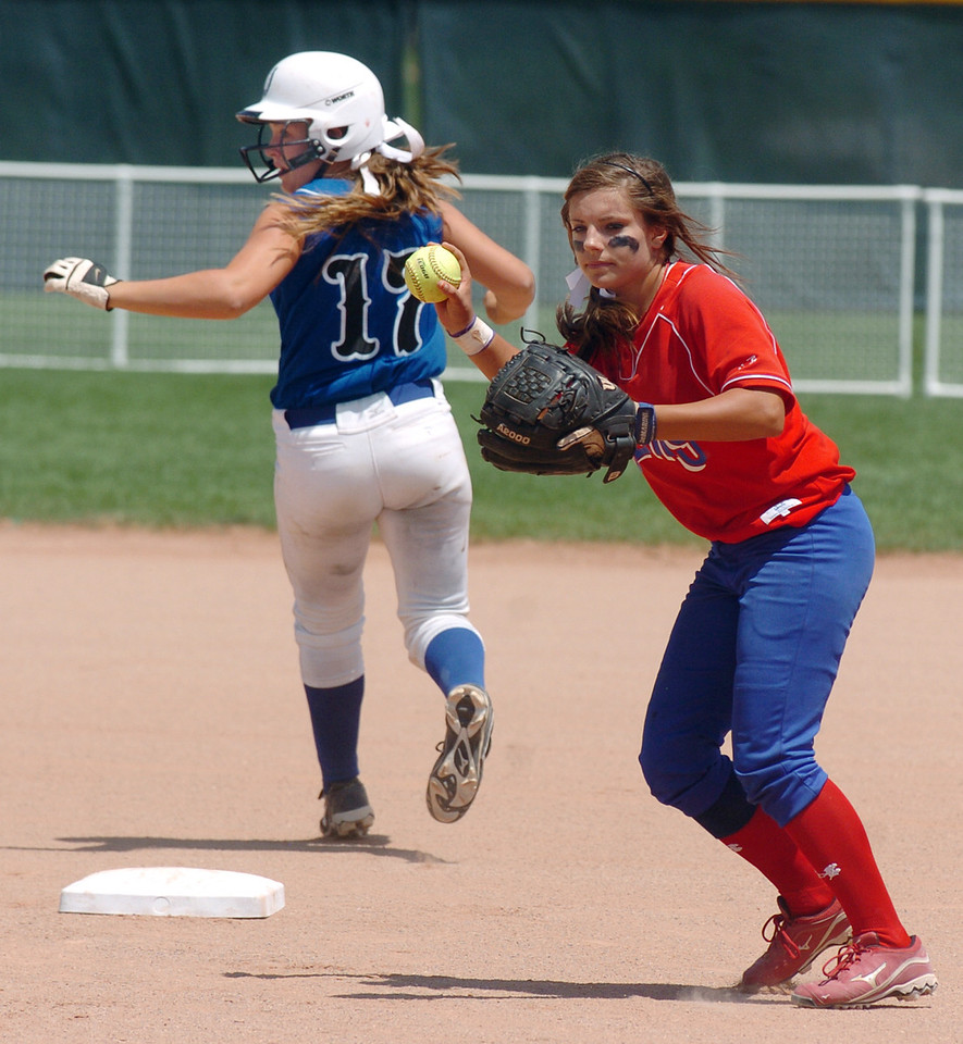 Texas Glory's T. Lynch, right, throws to firstbase after tagging out Birmingham Mustang's Bailee Hammock at secondbase during the 2011 Colorado Fireworks Softball Tournament 14U softball championship game at Community Park on Monday.<br /> <br /> <br /> June 25, 2011<br /> staff photo/ David R. Jennings