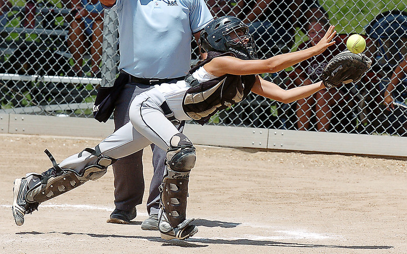 Kansas City Glory catcher Gaby Brown catches the ball to end the game against Colorado Stars during the 2011 Colorado Fireworks Softball Tournament 12U softball championship game at Community Park on Monday.<br /> <br /> July 4, 2011<br /> staff photo/ David R. Jennings