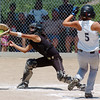 Colorado Stars catcher Val Ortega, left, catches the ball at home tagging out Kansas City Glory's Sahlyn Sutton during the 2011 Colorado Fireworks Softball Tournament 12U softball championship game at Community Park on Monday.<br /> <br /> July 4, 2011<br /> staff photo/ David R. Jennings