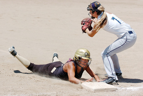 Kansas City Glory's Madison Heide, right, tags out Colorado Star's Bella Bravo at thirdbase during the 2011 Colorado Fireworks Softball Tournament 12U softball championship game at Community Park on Monday.<br /> <br /> July 4, 2011<br /> staff photo/ David R. Jennings