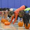 Great Pumpkin Workout participants exercise with their pumpkins at the Paul Derda Recreation Center on Thursday. 23 people worked out and made donations to FISH. <br /> October 25, 2012<br /> staff photo/ David R. Jennings
