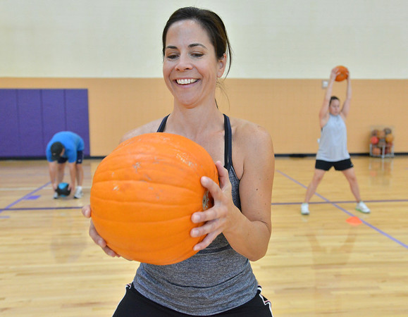 Shari Graham does curls with a pumpkin during the Great Pumpkin Workout at the Paul Derda Recreation Center on Thursday.<br /> October 25, 2012<br /> staff photo/ David R. Jennings