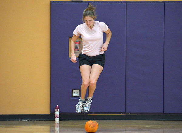 Katy Conway jumps over her pumpkin for an exercise during the Great Pumpkin Workout at the Paul Derda Recreation Center on Thursday.<br /> October 25, 2012<br /> staff photo/ David R. Jennings