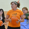 Haley Beaty, left, and Jean Rosecrans, right, follow the lead of instructor Lisa Walther, center, during the Great Pumpkin Workout at the Paul Derda Recreation Center on Thursday.<br /> October 25, 2012<br /> staff photo/ David R. Jennings