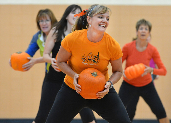 Instructor Lisa Walther, center,  performs an exercise with participants during the Great Pumpkin Workout at the Paul Derda Recreation Center on Thursday.<br /> October 25, 2012<br /> staff photo/ David R. Jennings